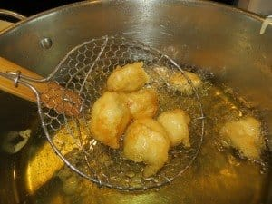 Chicken nuggets frying in oil