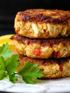 crab cakes stacked on a white plate