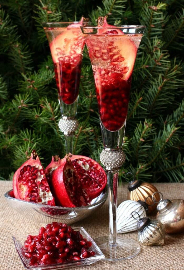 A Prosecco Holiday Pom Pom is a delicious Christmas champagne drink recipe with pomegranate seeds