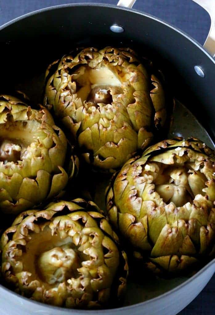 Stuffed Artichokes with Garlic and Fontinella Cheese are super tender when they're done, and filled with cheese!