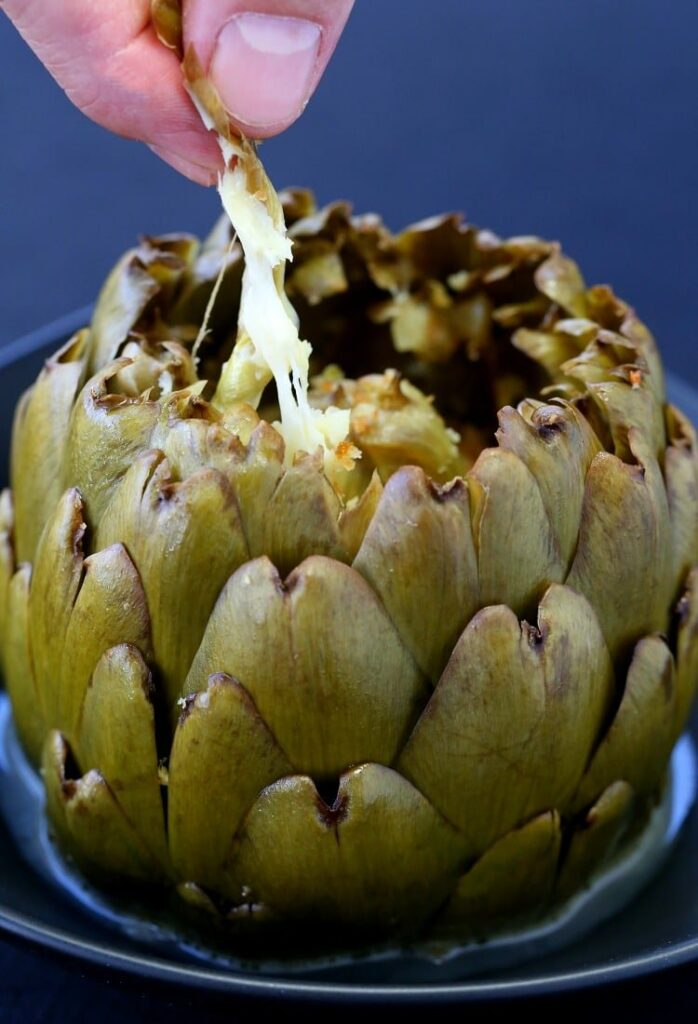 There's tons of flavor - and tons of cheese in these Stuffed Artichokes with Garlic and Fontinella!
