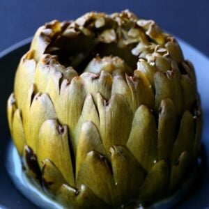 Stuffed Artichokes with Garlic and Fontinella Cheese are a delicious side dish or appetizer!