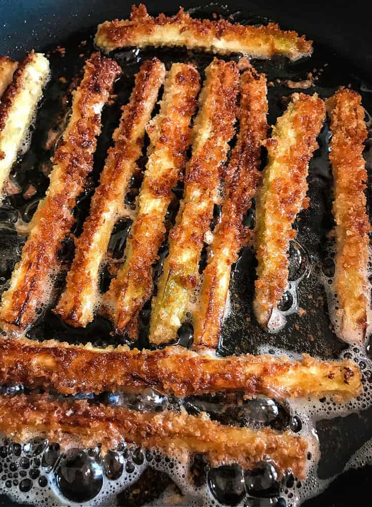 Eggplant fries in a skillet with oil