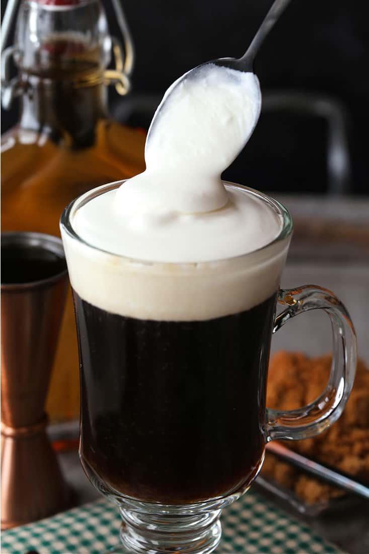 Cream being added to Irish Coffee drink