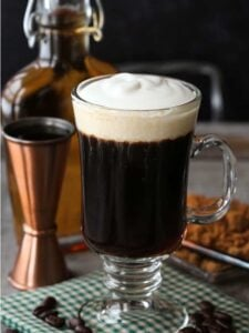 Irish Coffee in a glass mug with shot glass