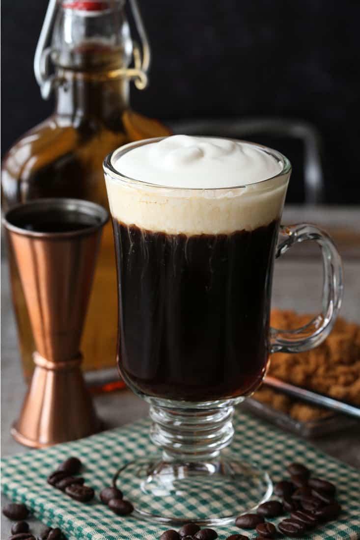 Irish Coffee in a glass mug with shot glass