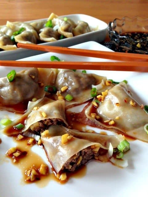 Pork and Ginger Pot Stickers on a plate with sauce