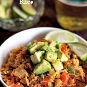 Chicken Fajita Rice in a bowl with limes and beer