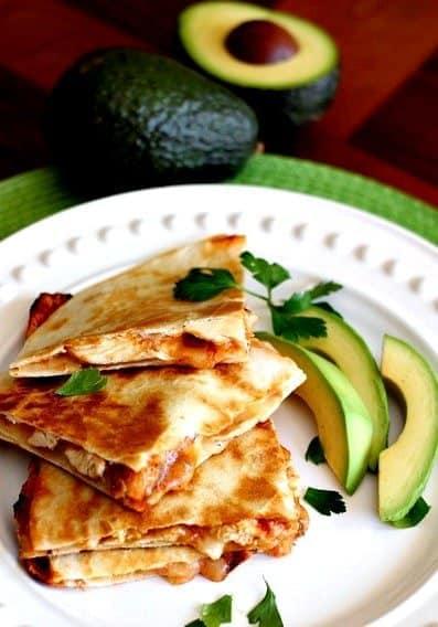 Chicken Enchilada Quesadillas with sliced avocado