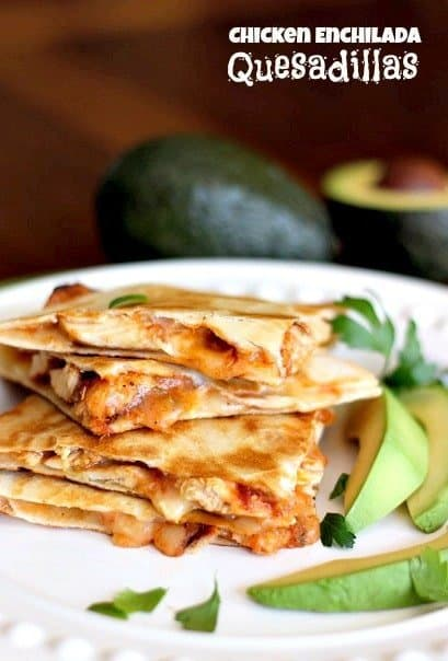 chicken enchilada quesadillas on a serving plate, stacked