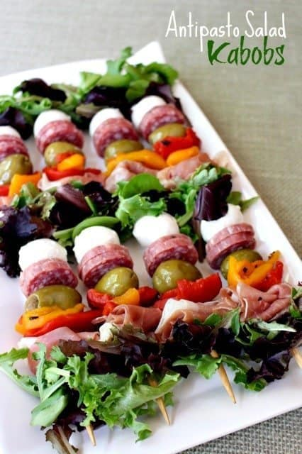 antipasto salad kabobs on a tray for serving