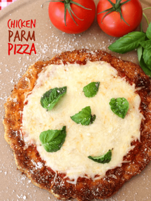 Chicken Parm Pizza with title on a pizza stone