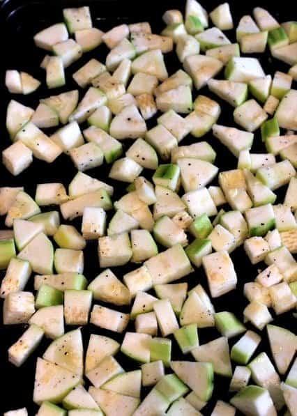 zucchini chopped on a sheet pan