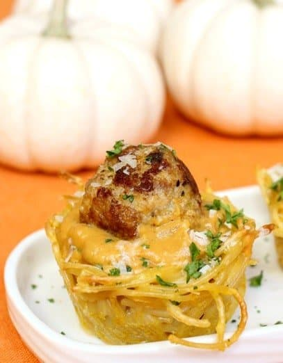 Spaghetti and Meatball Cups with Pumpkin Sauce on a platter