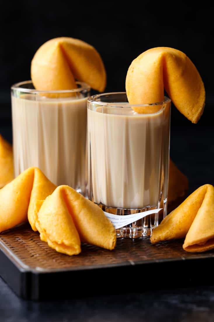 fortune cookie shots on a board with cookies