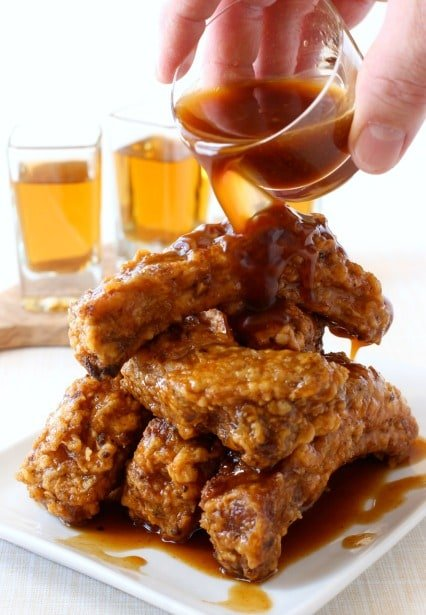 Chicken Fried Ribs with Whiskey Glaze are a deep fried rib recipe coated in a whiskey glaze