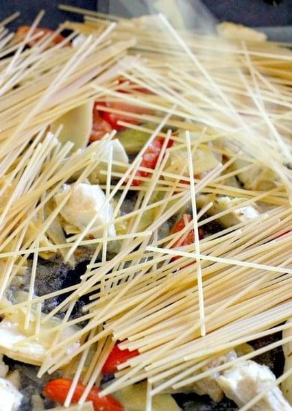 pasta in skillet for shrimp and artichoke pasta