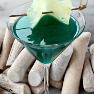 Seven Seas Martini is a martini recipe made with blue curacao