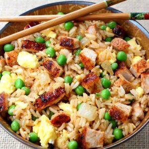 BBQ Pork Fried Rice recipe in a bowl with chop sticks