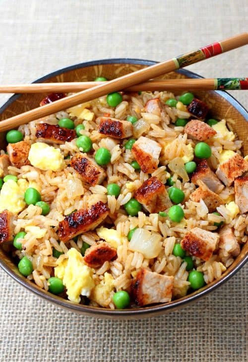 BBQ Pork Fried Rice recipe in a bowl with chop sticks