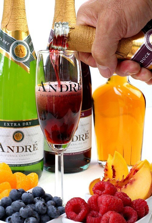 Pouring champagne for Champagne Sangria