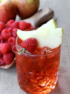 Raspberry Cider Whiskey is a cold cider cocktail with whiskey and raspberries