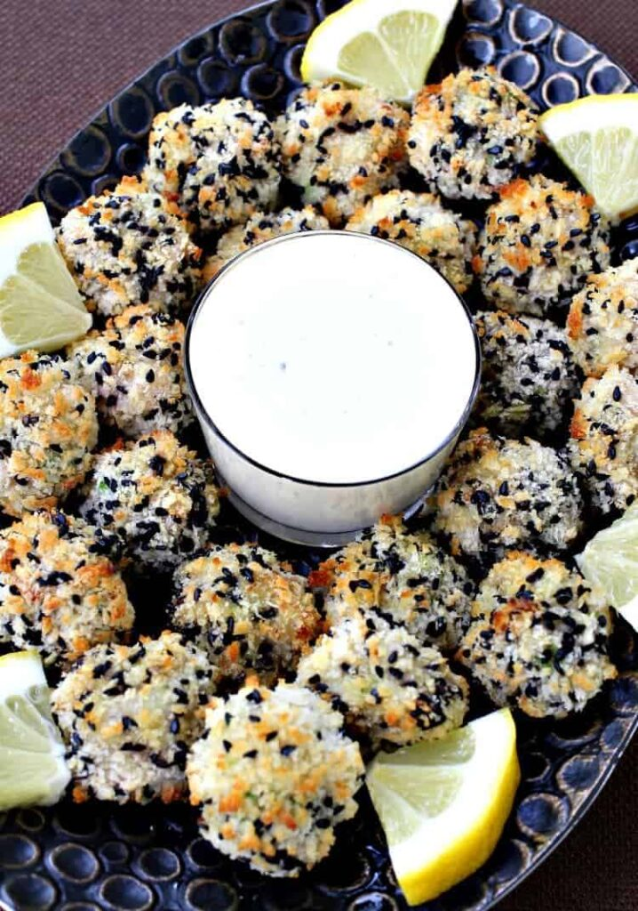 Sesame Shrimp Bites with Lemon Aioli on a platter with lemon wedges