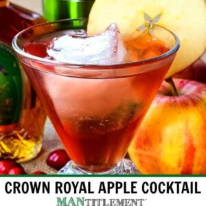 Crown Royal Apple cocktail in a glass with an apple slice and fresh cranberries