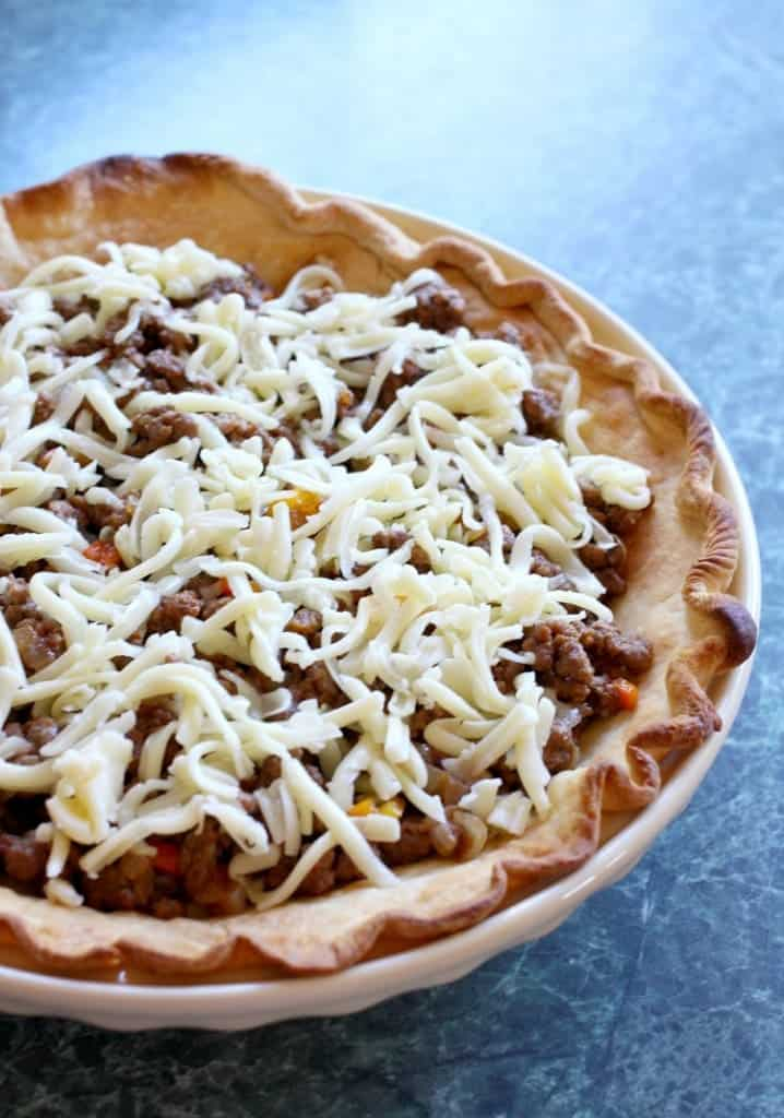 Loaded Taco Pie filling is beef and cheese then topped with taco toppings