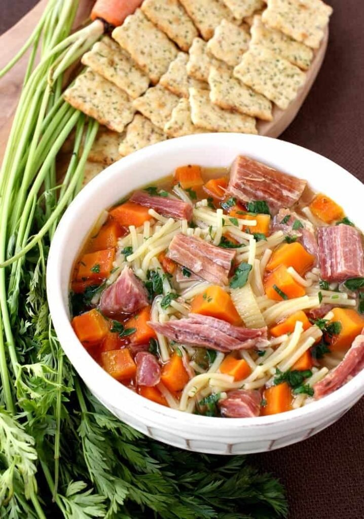 Slow Cooker Ham and Noodle Soup is a slow cooker soup recipe with noodles and carrots