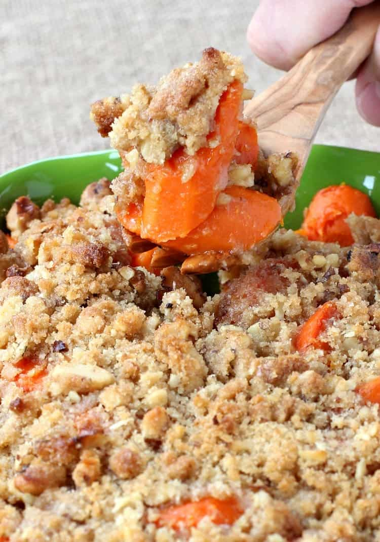 oven roasted carrots with a streusel topping in a green dish