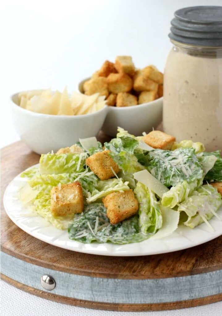 Homemade Creamy Caesar Salad Dressing on a plate with croutons