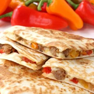 Sausage and Pepper Quesadillas stacked on a plate