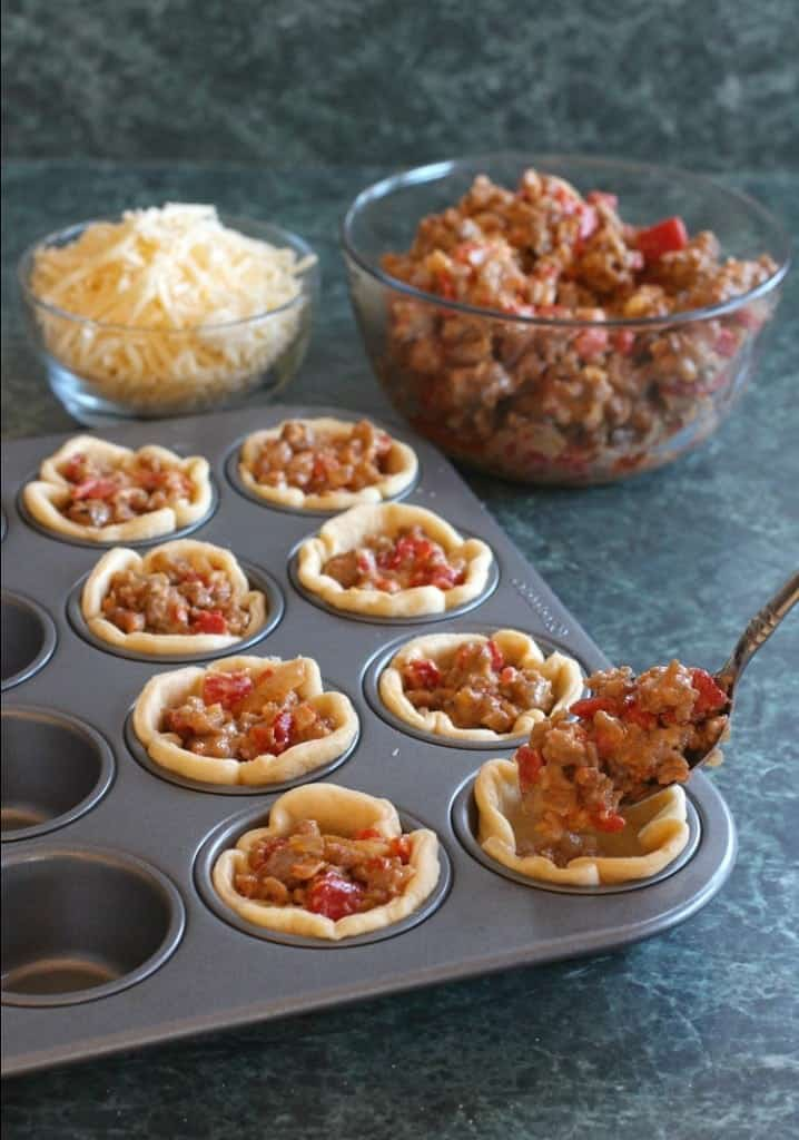 Sausage and Pepper Crescent Cups are filled with sausage and peppers and topped with cheese