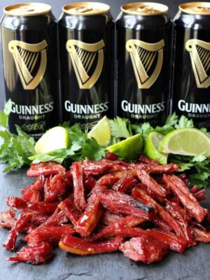 shredded corned beef and sliced limes with beer cans
