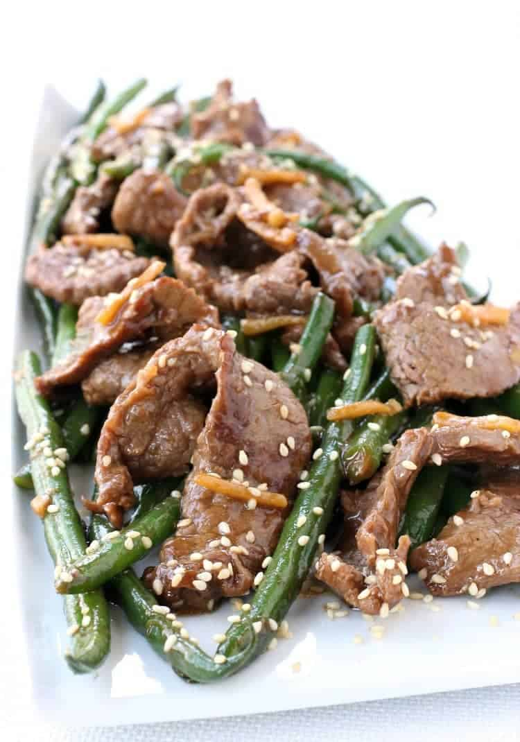 Ginger Beef and green bean stir fry on a white plate