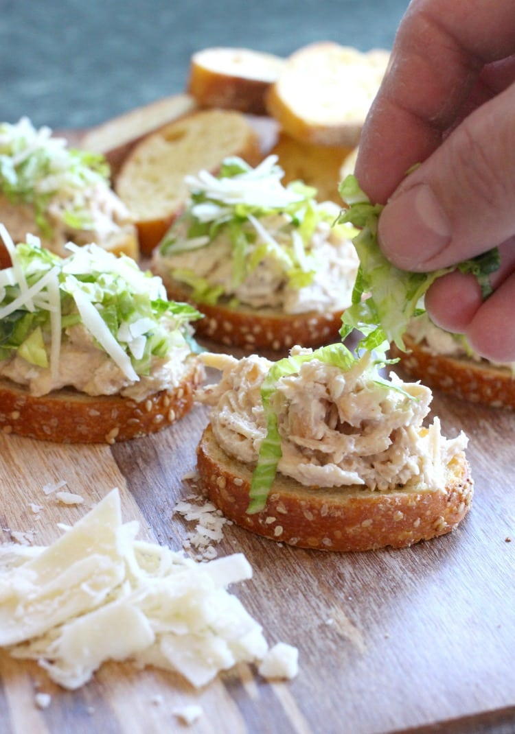 Caesar Chicken Salad Bruschetta is a chicken salad recipe that's topped with lettuce and parmesan cheese