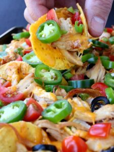 chicken sheet pan nachos on a tray