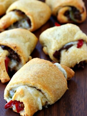Philly Cheesesteak Crescent Rolls on a wood board