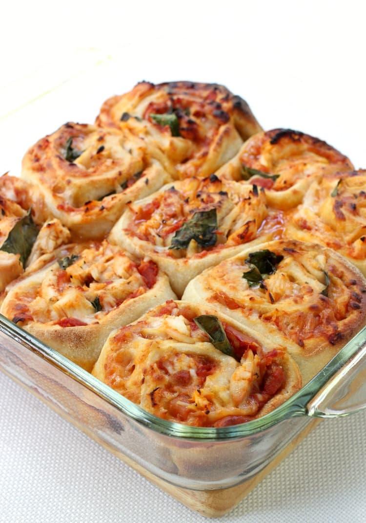 Saucy Chicken Pizza Rolls in baking dish