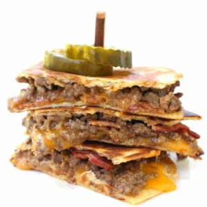 cheeseburger quesadillas cut and stacked on a plate