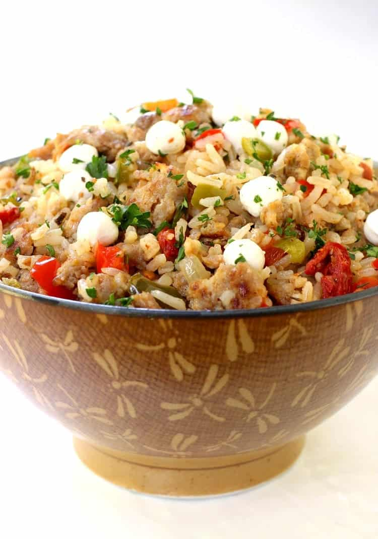 Italian Fried Rice is a fried rice recipe that has Italian flavors like sausage, cheese and peppers