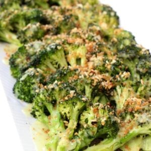 roasted broccoli with breadcrumbs and Hollandaise sauce on a platter