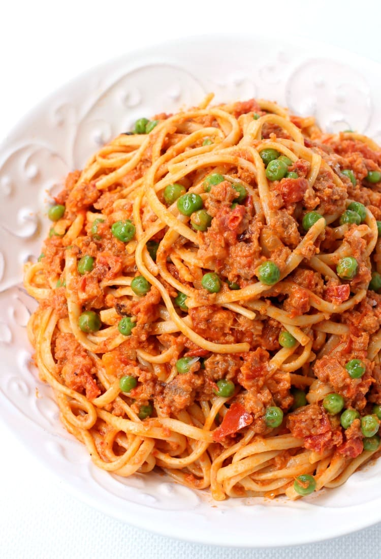 Creamy Sausage Spaghetti with sausage and peas is going to become your new favorite dinner!