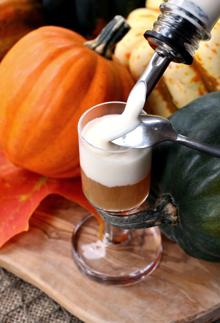 These Jack-O-Blast Pumpkin Rum Shooters get a layer of whipped boozy cream on top!
