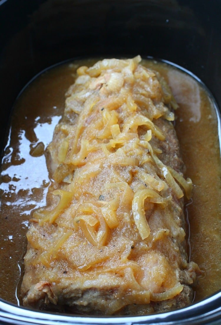 This Crock Pot Applesauce Pork Roast cooks all day but is still a sliceable roast