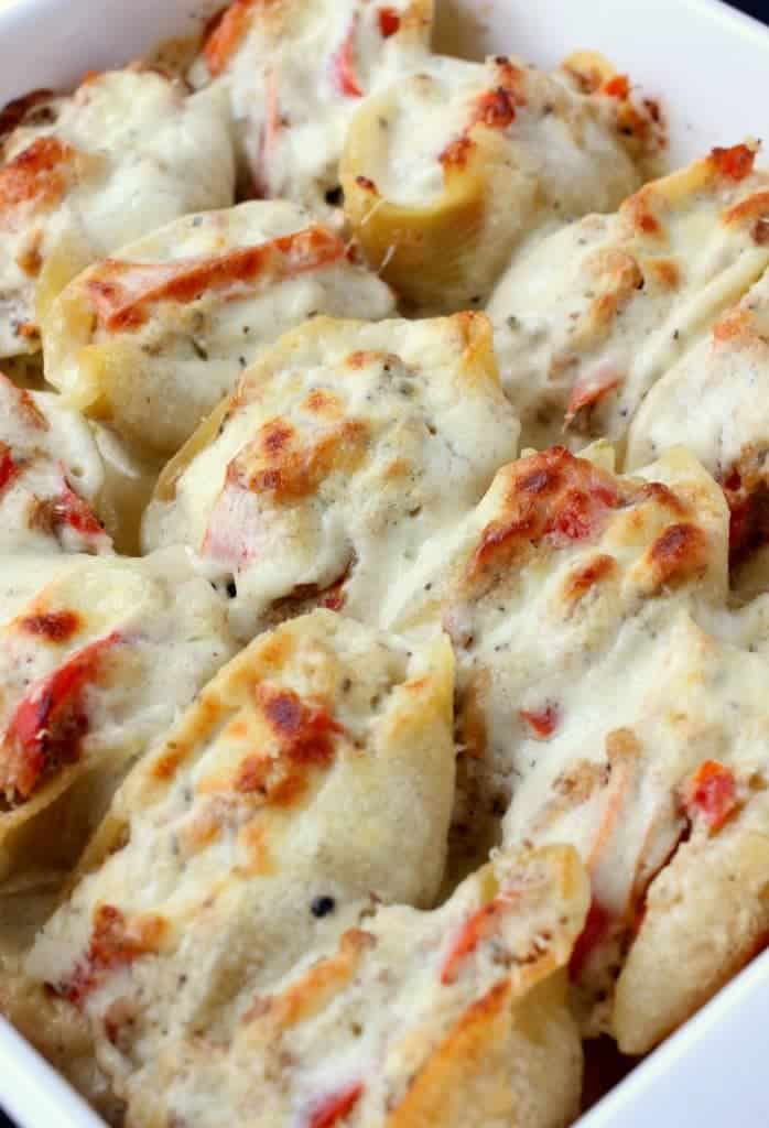 Philly Cheesesteak Stuffed Shells are browned in the oven with a creamy sauce underneath!