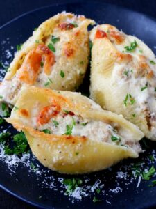 Philly Cheesesteak Stuffed Shells are filled with a cheesy, creamy beef and pepper filling then covered in alfredo sauce!