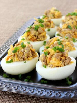 These Sausage and Hash Brown Deviled Eggs are the ultimate guy food - sausage, potatoes and eggs in one bite!