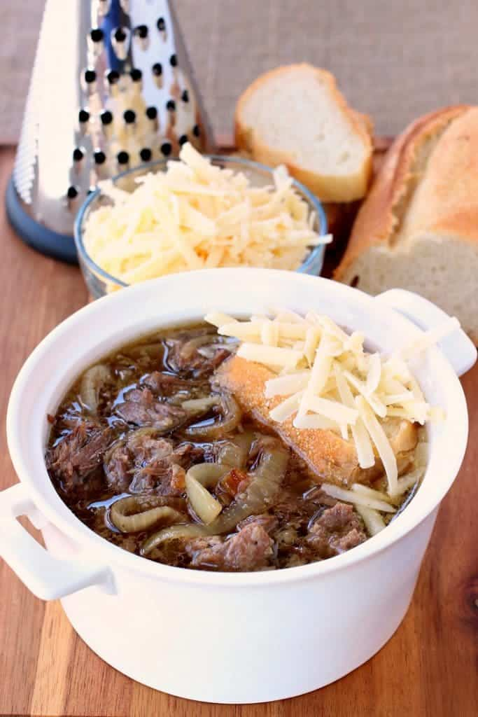 Slow Cooker Beefy French Onion Soup gets topped with bread and gruyere cheese then baked!